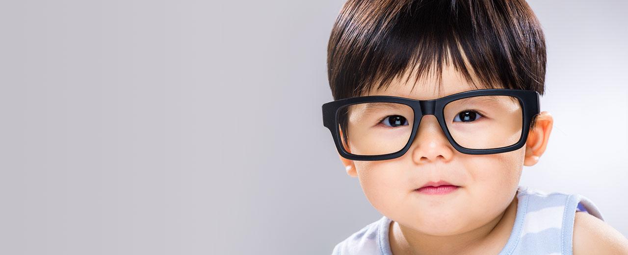 Baby wearing oversized eyeglasses