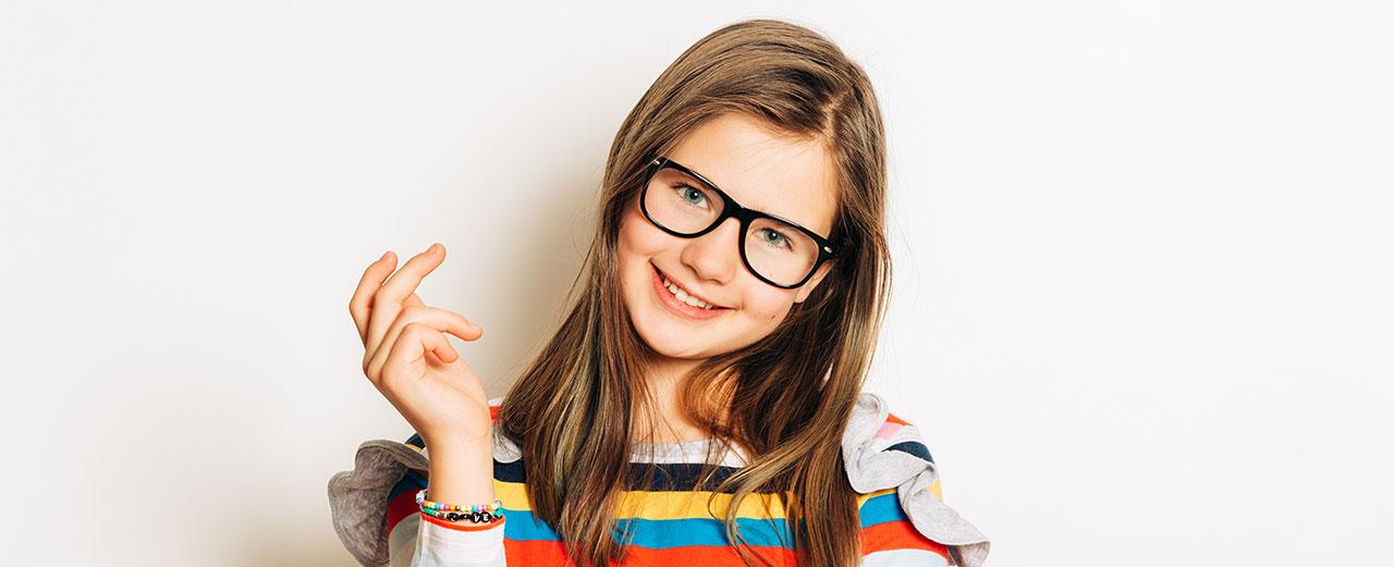 young female child wearing eyeglasses